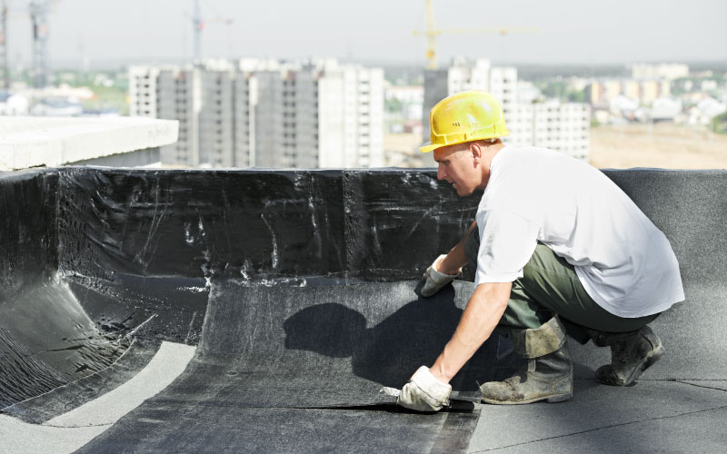 Man working on flat roofing